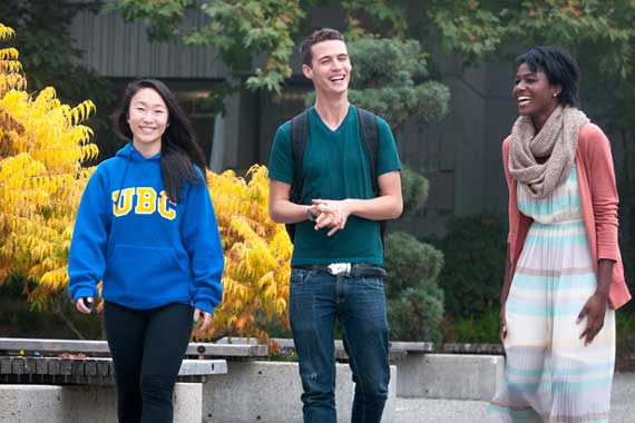 Three UBC students walking together.