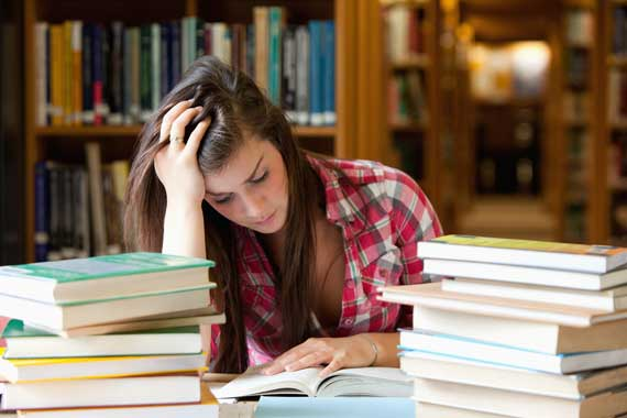 Worried female student in a library