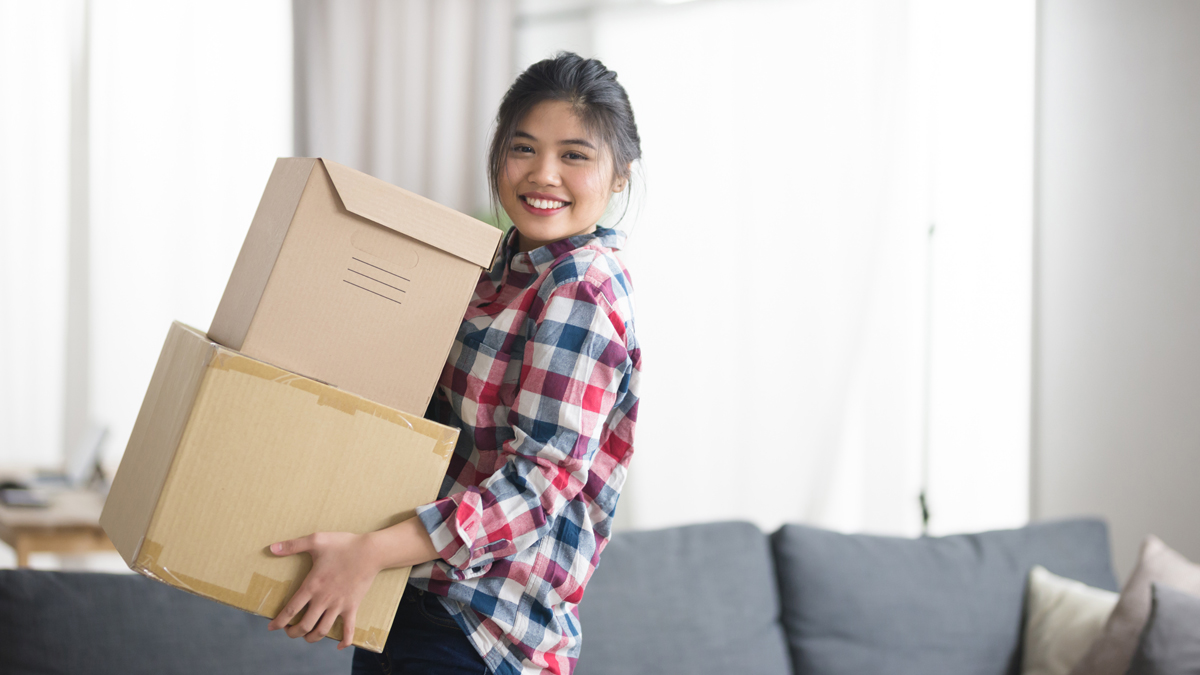 Young woman with packing boxes